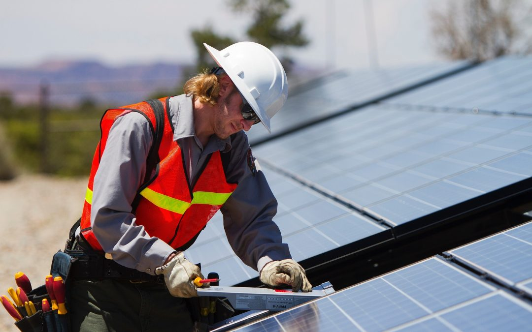 On site generation for small business, Solar panel worker